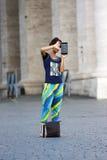 Tourist woman taking a photo Stock Photo