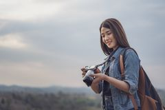 Tourist woman taking photo with her camera in nature royalty free stock image