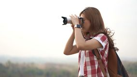Tourist woman taking a photo with camera in nature. Tourist woman taking a photo with her camera in nature stock footage
