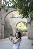 Woman taking alhambra picture royalty free stock photo