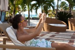 Woman taking travel picture with phone stock photography