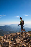 Tourist woman on the top of mount, Stock Photo