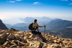 Tourist woman on the top of mount, Stock Photography