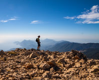 Tourist woman on the top of mount, Royalty Free Stock Photography