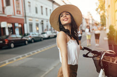 Tourist woman using bicycle Royalty Free Stock Images