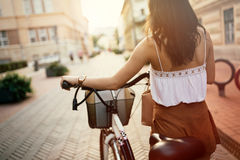 Tourist woman using bicycle Stock Photography