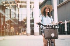 Tourist woman using bicycle Stock Photos