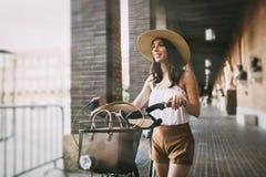 Tourist woman using bicycle Royalty Free Stock Photos