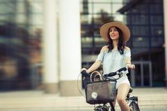 Tourist woman using bicycle Royalty Free Stock Photo