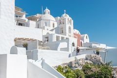 Tourist woman on vacation in Thira walking on stairs. royalty free stock image