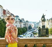 Tourist woman on Vaclavske namesti in Prague having excursion. The spirit of old Europe in Prague. happy modern tourist woman on Vaclavske namesti in Prague Stock Photos