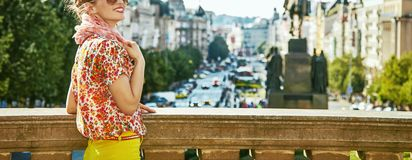 Tourist woman on Vaclavske namesti in Prague having excursion. The spirit of old Europe in Prague. happy modern tourist woman on Vaclavske namesti in Prague Stock Images