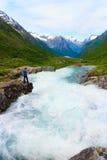 Tourist woman by Videfossen Waterfall in Norway Stock Image