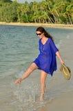 Tourist woman walks along a tropical beach in Fiji Royalty Free Stock Photography