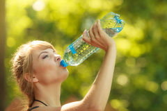 Tourist woman with water bottle outdoor Royalty Free Stock Image