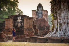 Tourist women take a photos at Sukhothai historical park, Mahathat Temple. Sukhothai ,Thailand Royalty Free Stock Images