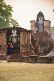 Tourist women take a photos at Sukhothai historical park, Mahathat Temple. Sukhothai ,Thailand Stock Image