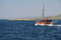 Tourist wooden boat in the Aegean Sea. Greece Stock Image