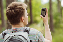 Tourist  in the woods determines location using gps Royalty Free Stock Image