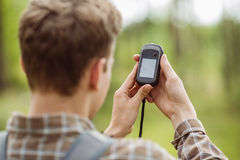 Tourist  in the woods determines location using gps Stock Photography