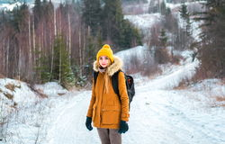 Tourist in the woods in winter Royalty Free Stock Photo