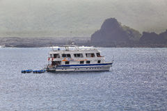 Tourist yacht anchored near Santiago Island in Galapagos Nationa Stock Photo