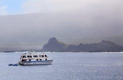 Tourist yacht anchored near Santiago Island in Galapagos Nationa Stock Photos