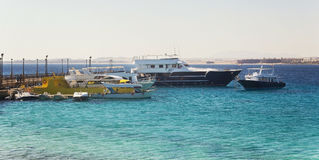 Tourist yachts and boats near the pier in Hurghada. Egypt. Stock Images