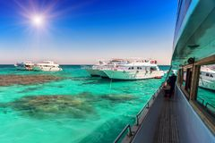 Tourist yachts in the sea royalty free stock image