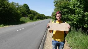 Tourist in a yellow T-shirt with a sign is upset stock video footage