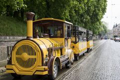 Tourist yellow train. stock photos