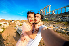 Tourist young couple near Poseidon temple in Greece Stock Photography