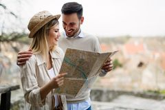 Tourist young couple using map as guide royalty free stock images
