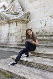 Tourist.Young girl with map in roma Stock Image