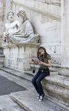 Tourist.Young girl with map in roma Royalty Free Stock Image