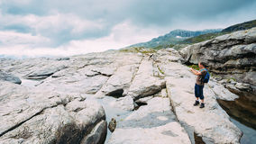 Tourist Young Man Photographs Beautiful Landscape Of Norwegian M Royalty Free Stock Photo
