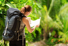 Young woman with backpack in a woods Stock Photo