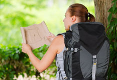 Young woman with backpack in a woods Royalty Free Stock Photography