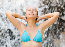 Young woman relaxing in waterfall Royalty Free Stock Photography