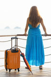 Young woman with suitcase on the pier Royalty Free Stock Photos