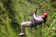 Tourist On Zip Line In Ecuadorian Rain Forest Royalty Free Stock Image