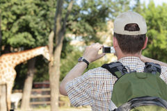 Tourist in the zoo Stock Photography