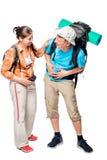 Touriste avec la douleur abdominale et la diarrhée dans la hausse, couple sur le blanc Photo libre de droits