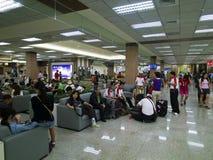 Touriste dans l'aéroport de Taïpeh Songshan Photo stock