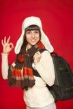 Touriste de femme d'hiver avec le sac à dos Images libres de droits