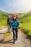 Touriste de fille avec un sac à dos Photographie stock libre de droits