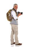 Touriste supérieur regardant en arrière Photo libre de droits