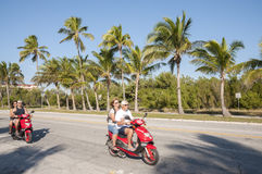 Touristen auf Rollern in Key West Lizenzfreies Stockfoto