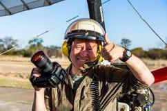 Touristen vor dem Flug über Victoria Falls auf trikes Lizenzfreies Stockfoto