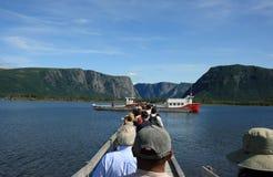 Touristen in westlichem Bach-Teich Stockfotografie